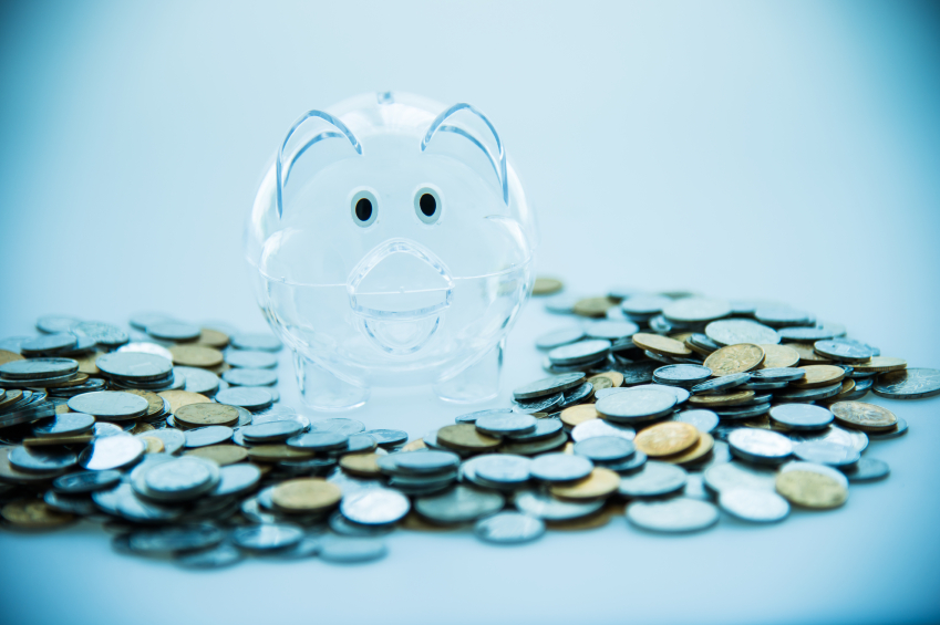 Plastic piggy Bank on pile of coins